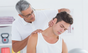Male Chiropractor Adjusting Man's Neck